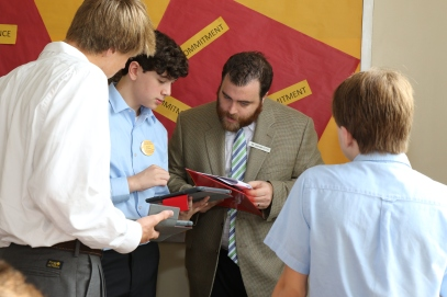 Mr. Graham Otton '05 assists students in Canvas, Chaminade's new Learning Management System, on their iPads.