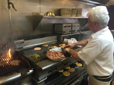 A chef at Station Plaza Coffee Shop and Diner prepares a variety of dishes to meet the incoming lunch rush.