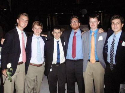 (l.-r.) Paul Gomez '16, Clark Newby '17, Mr. Joseph Amorizzo '07, Mr. Matthew Chicavich '98, Sean Maleady '17, and Matt Meade '17 pose for a photos near the altar at MSG.