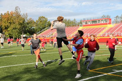 Colin Hanley '18 jumps up for a completion during a game of ultimate frisbee.
