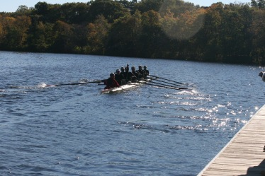 Chaminade's varsity eight boat heads out of the dock to test the waters of the Charles River.