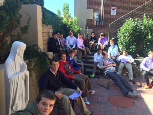Homeroom 2L gathers in the courtyard of Saragossa to listen to a lecture by Mr. Matthew Chicavich '98.