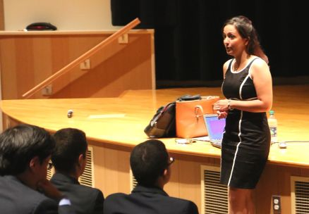 Ms. Crystal Berger, a field organizer for the Nassau County Democratic Party, speaks to junior and senior members of the Social Studies Club in Hearst Auditorium.