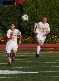 Tim Davis '17 and James Donnelly '16 chase a stray ball.