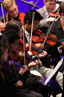 Matt Tsang '18 plays the violin plays alongside classmate, Matt Chang '17 and musicians from University of Dayton.