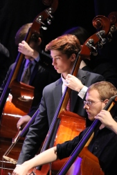 Brendan Finnerty '16 plays the standing bass along with classmates and Dayton performers.