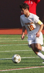 Nicholas Lavinio '16 is gaining control of the ball, with no interference from opponents.