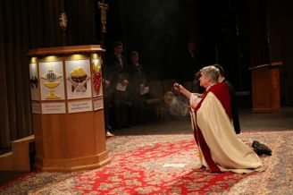 School chaplain, Father Garrett Long S.M. '62, spreads incense in front of the Eucharist at the Sodality Prayer Service.