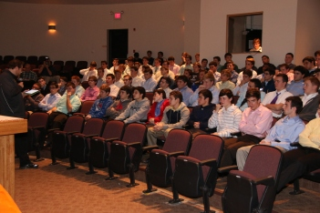 Mr. Matthew Chicavich '98 speaks to the senior class about the religious aspect of the event.