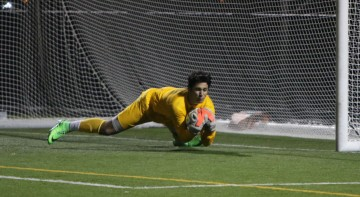 Goalkeeper Yanni Rigos '17 makes ones of many saves in the NSCHSAA Finals.