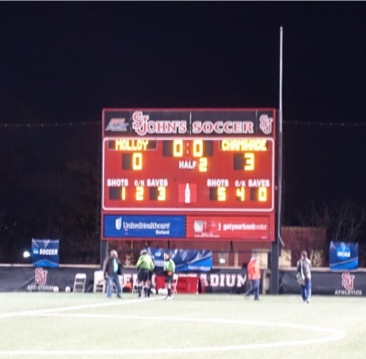 The scoreboard proudly displays a 3-0 Chaminade victory at the end of the 2nd half.