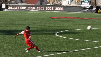 Kevin Lee '16 launches a pass downfield to teammates.