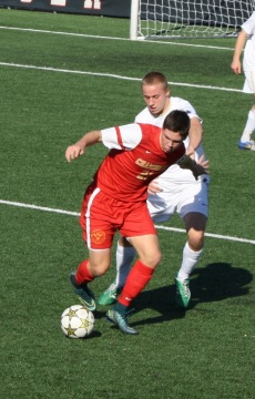 Junior Matt Vowinkel battles with a Crusader defender as he attempts to get the offense going.