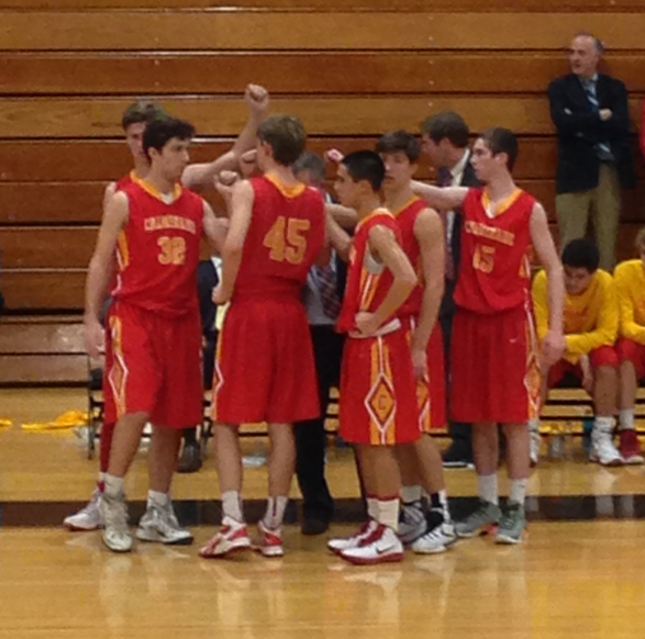 Chaminade's Varsity Basketball athletes break their huddle after a discussion with their coach, Mr. Daniel Feeney.