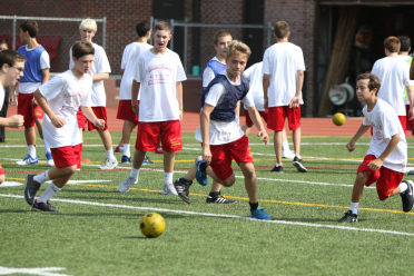 A friendly game of soccer is played between freshman homerooms during 3-C Week.