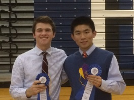 Robert Sangirardi '16 (l.) and Vincent Sciortino '16 (r.) pose for a photo with their first place medals in Optics.