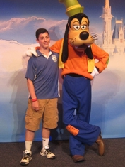 Alex Ptacek '15 takes a picture with Goofy during the senior trip to Disney World.