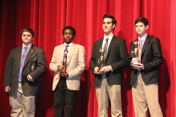 (l-r.) Joseph Moses '19, Kenneth Bradley '18, Michael Carolan '17, and Walter Szech '18, show off their trophies after receiving highest honors in their respective categories.