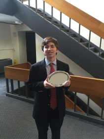 Aidan Fitzgerald '18 displays the platter he received as a reward for being the 5th best speaker in JV Lincoln-Douglas for the Harvard Invitational Tournament.