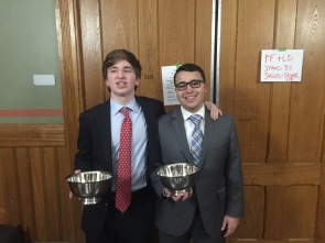 (l.-r.) Aidan Fitzgerald '18 and John Michael Magliore '18 present their quarterfinalist awards for JV Lincoln-Douglas debate.
