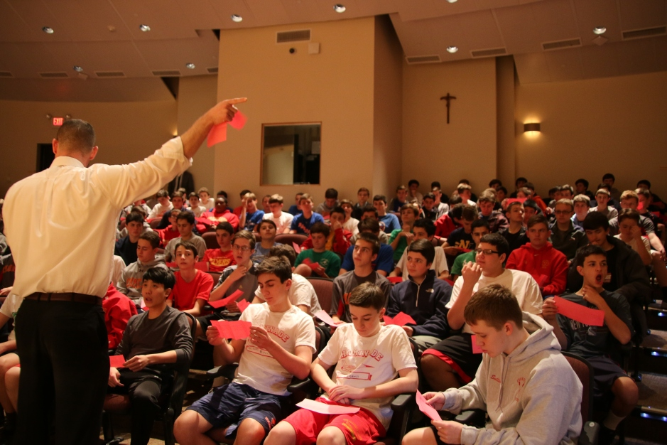 Mr. Michael Foley '99 informs the members of the Class of 2019 about the evening's plans.