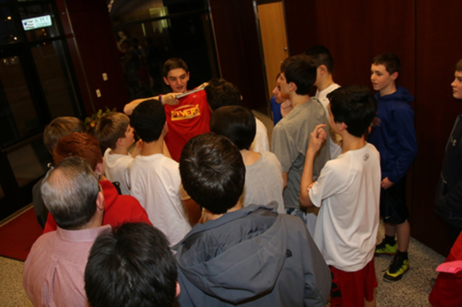 """Brian Patton '19 speaks to his homeroom while holding up an iPad during a game of """"Heads Up""""."""