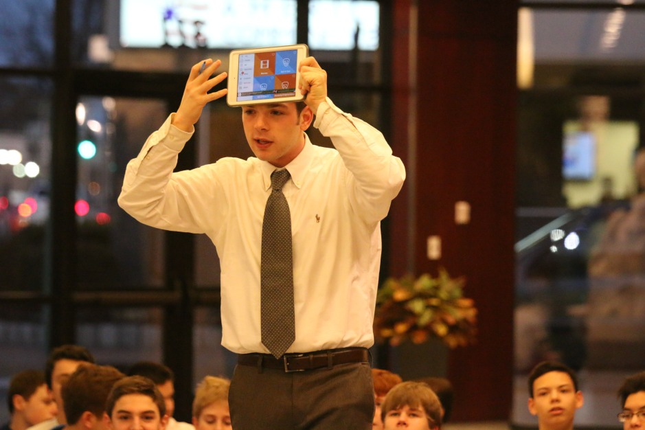 "Mr. Patrick Cahill '11 participates in a game of ""Heads Up"" with members of the freshmen class."