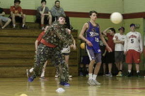 Now you see him: Joe Jansen 3F lobs a ball dressed in his ghillie suit.