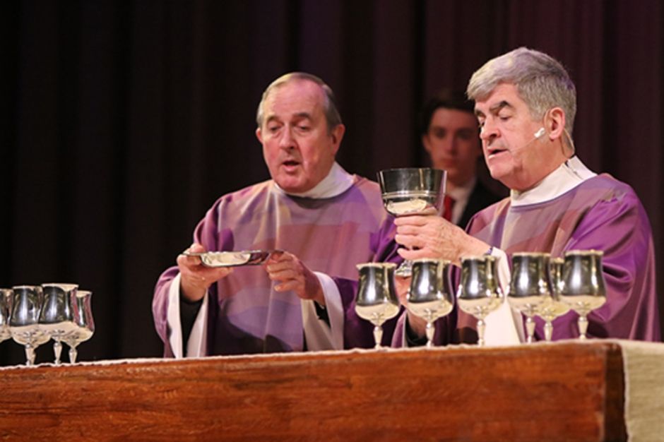(l.-r.) Father Ernest Lorfanfant S.M. '55 and Father Garret Long S.M. '62 preside over the Body and Blood of Christ.