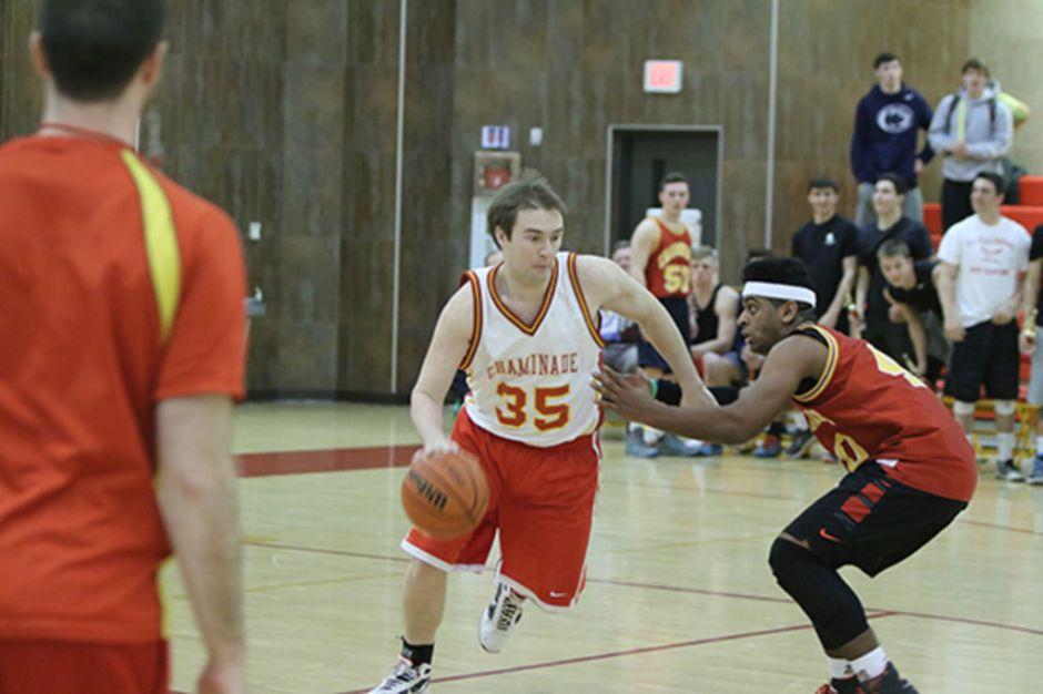 Mr. Daniel Feeney, head freshman basketball coach, jukes out opponent Tyler Toussaint '16.