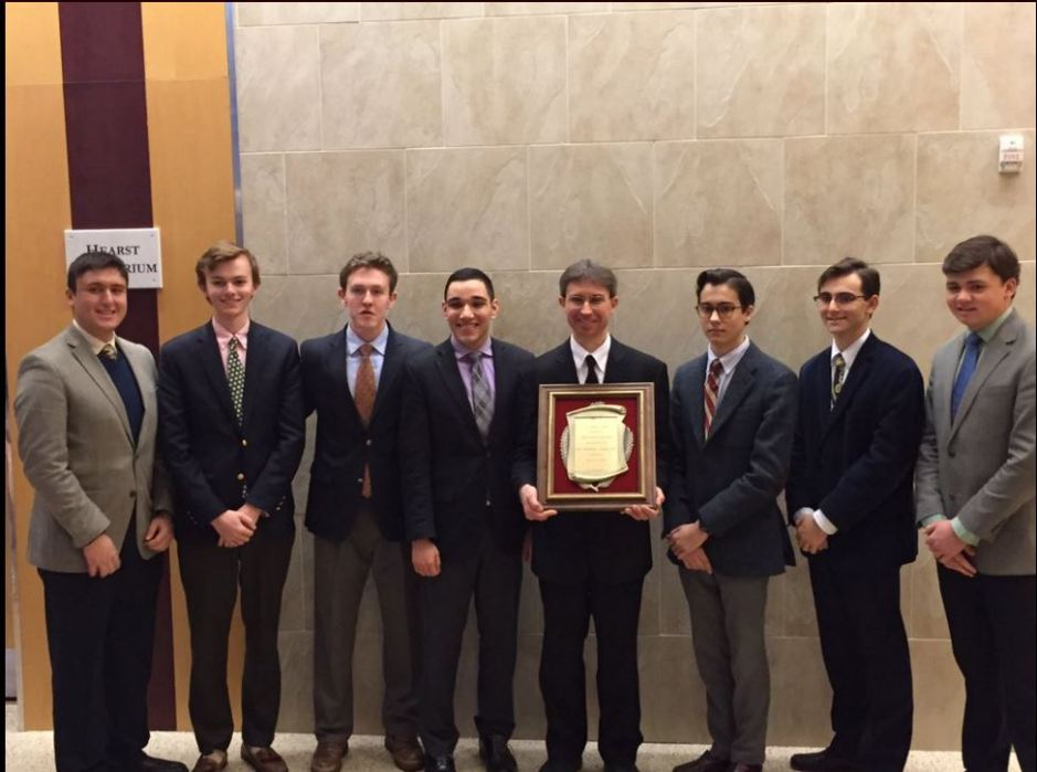 Senior members of the Crimson and Gold editorial staff, (l.-r.) Robert Paradiso, Andrew Hertlein, Owen Corrigan, Michael Navarrete, Andrew Garcia, Eli Jaghab, and Brandon Teixeira, stand with Bro. Benjamin Knapp S.M. '93 after awarding him with the yearbook dedication.