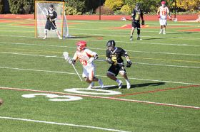 Captain Thomas Martello '16 attempts to score while being close guarded by a St. Anthony's defenseman.