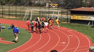 The three Chaminade racers fight to advance in the pack while running around a bend.