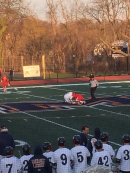 Jack Giovannetti '17 attempts to gain an offensive lead for the Flyers by winning a faceoff.