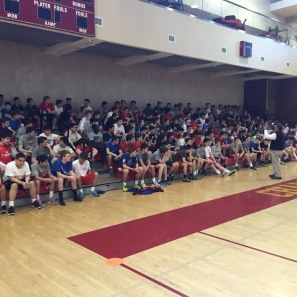 Coach Robert Pomponio explains the instructions for an upcoming handball tournament to over 200 students.
