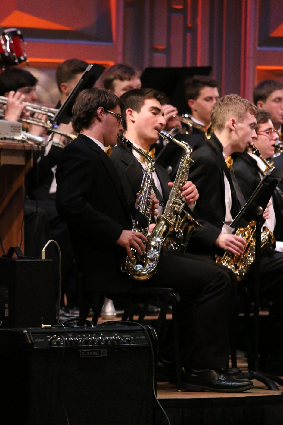 Gold Band's saxophone section harmonizes during the concert.