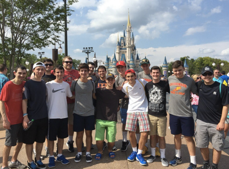 Students and teachers pose for a picture in front of Cinderella's Castle.