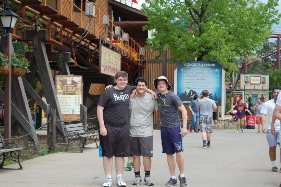 Christian Matlempi '17, Tony Ramos '17, and Patrick Johnson '17 stand outside Runaway Mine Train.