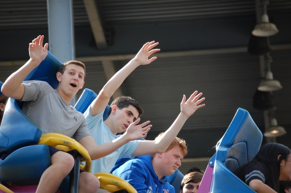 Chris Morici '17, Kian Lotruglio '17 , Dan Leno '17, and Jonathan Vella '17 put their hands in the air as they plummet down Nitro.