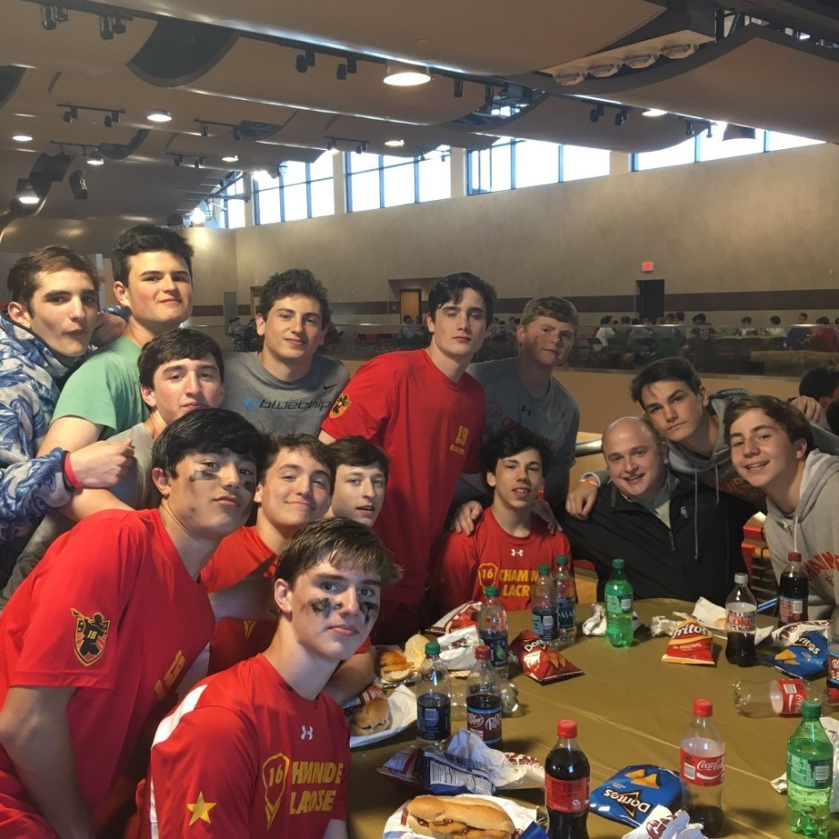 Bro. Daniel Griffin, S.M, eats with members of the JV B lacrosse team after their impressive victory over St. Anthony's.