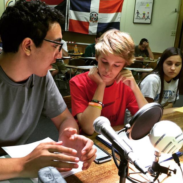 Using the genuine tools of the trade, campers practice broadcasting sporting events.