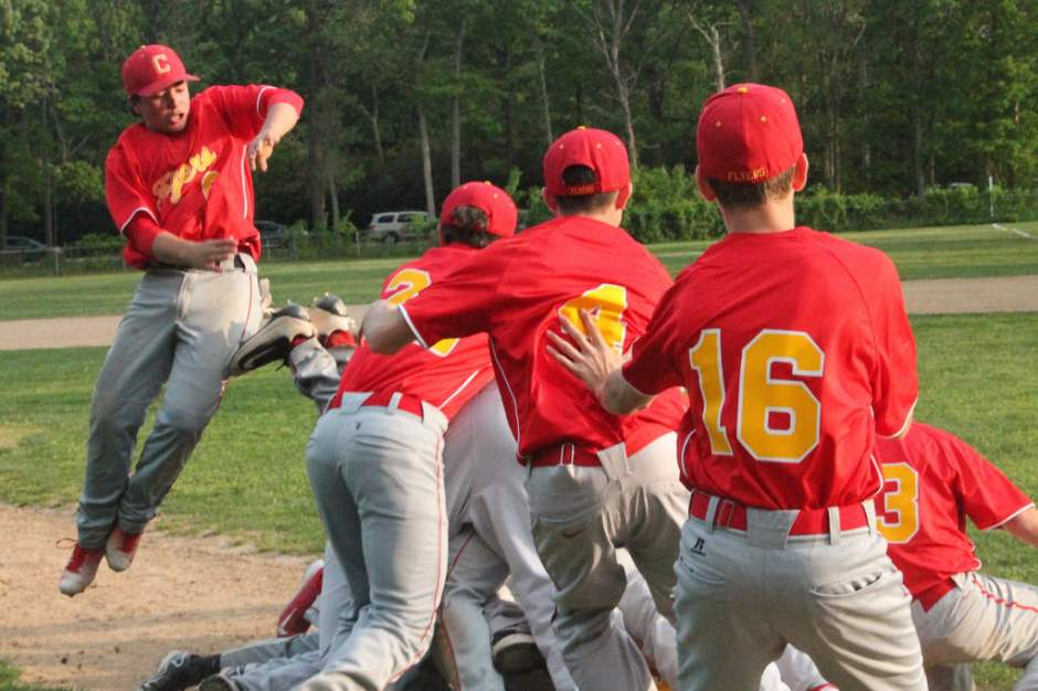 Enraptured by the glory of winning the league championship, the JV baseball team dogpile on top of one another in a pure expression of camaraderie.