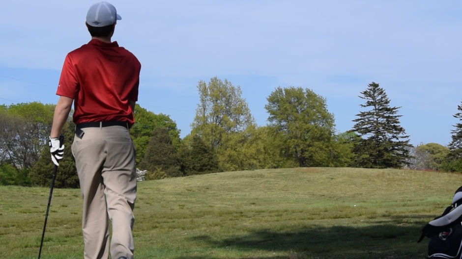 Dulaney Glen '18 watches as his perfectly aimed shot descends through the air and onto the course.