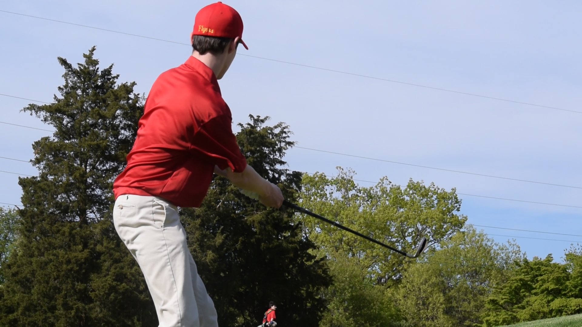Alek Dembo '18 elegantly swings his club to move onto the green.