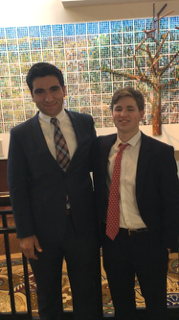 Peter Charalambous '16 and Aidan Fitzgerald '18 meet in the lobby after their final round on Saturday.