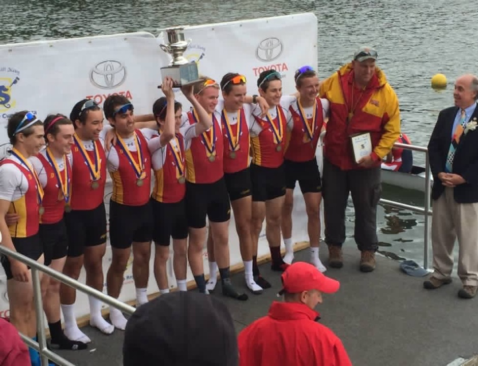 Rowers from the JV Eight Boat are awarded medals and a trophy for their dominant performance.