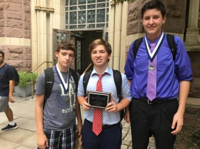 (l.-r.) Tim Franz '19, Aidan Fitzgerald '18, and  Sean Lochner '19 stand with their awards just outside Yale's famous Battell Chapel.
