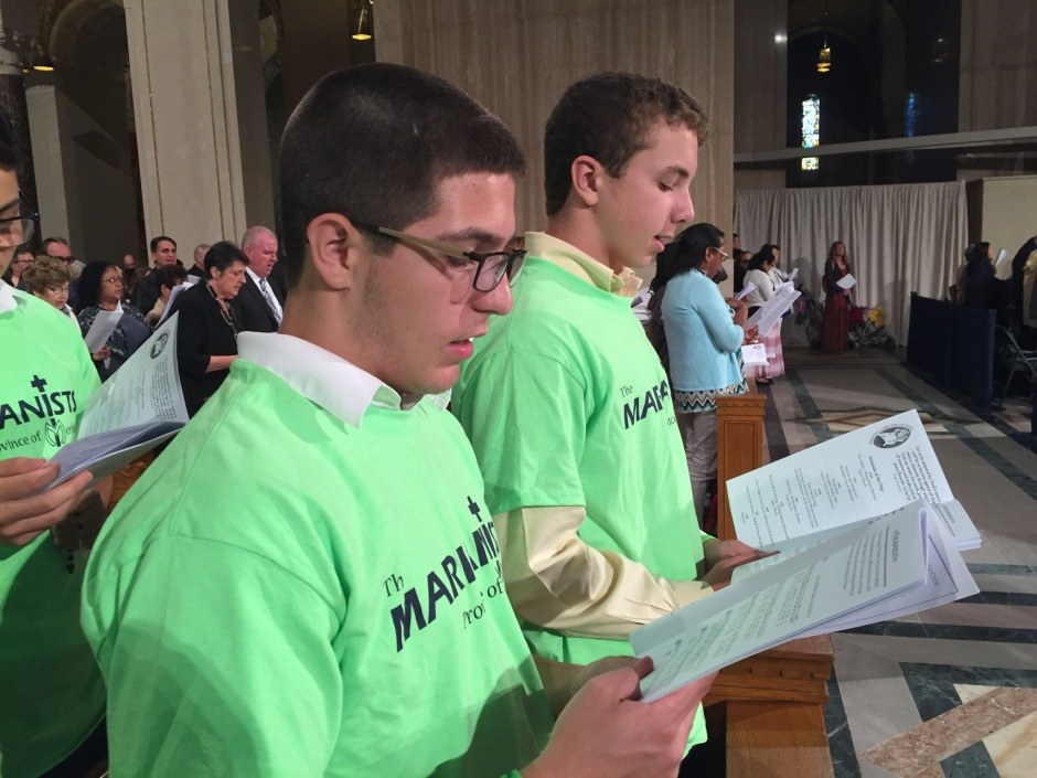 Nicholas Balylis (l.) and Sean Cunnane (r.) sing at Mass during the pilgrimage in Washington D.C.