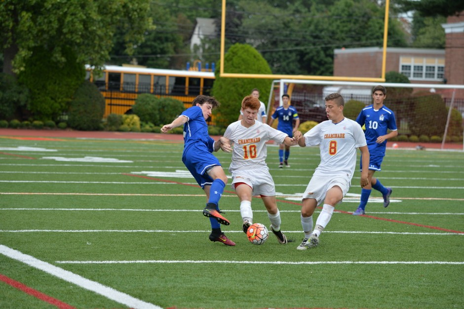 Seniors Tim Davis and Jack Nuttall lunge for a loose ball near midfield in Chaminade's 5-1 victory over Kellenberg.