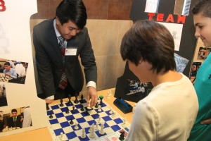 Interested prospective students see what it is like to be on Chaminade's chess team, by playing Colin Cheung '17.